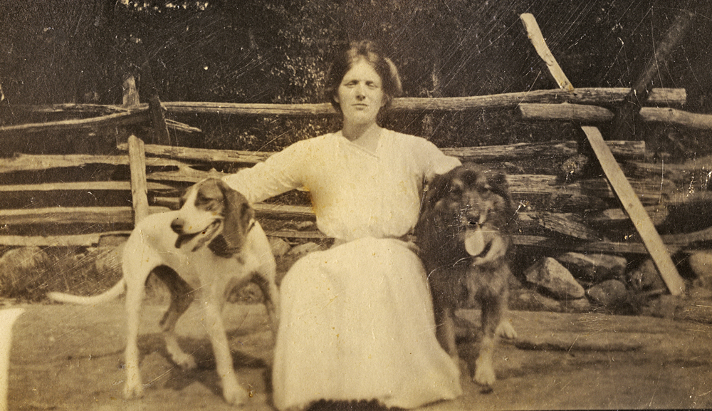Photo of a young Lucy Seger with hounds
